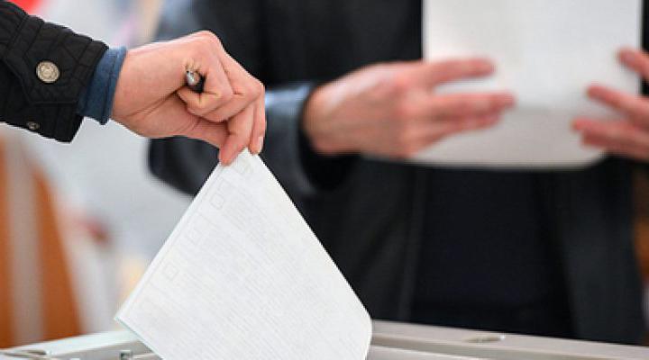 участь у виборах мігрантів