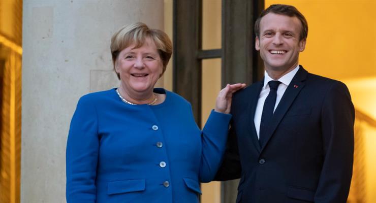 Макрон і Меркель зустрічаються в Парижі, щоб обговорити глобальну кризу і ЄС